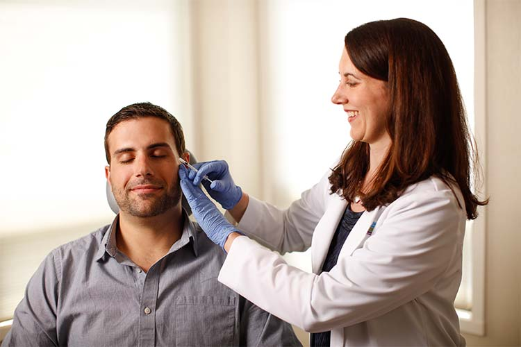 Male patient being injected on the face