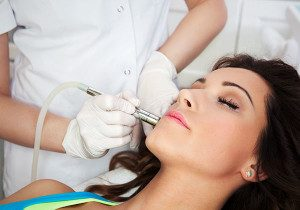 woman in treatment room getting microdermabrasion